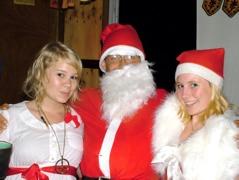 Santa and his helpers at our Christmas Kirtan - Hannah, Chaitanya & Amber