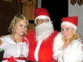 Santa and his helpers at our Christmas Kirtan - Hannah, Chaitanya & Amber